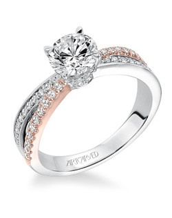 Mimi, Classic two tone prong set diamond engagement ring with asymmetrical diamond accented split shank in rose and white gold. Available in Platinum, 18K and 14K gold. Price listed below is for the setting only. Settings can be custom made to fit any size or shape center stone. Total weight of semi-mount 1/3 Ct. Matching band available - Style number V579W-L
