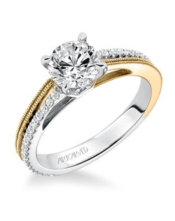 Laney, Contemporary two tone prong set diamond engagement ring with asymmetrical milgrain and diamond accented shanks in yellow and white gold. Available in Platinum, 18K and 14K gold. Price listed below is for the setting only. Settings can be custom made to fit any size or shape center stone. Total weight of semi-mount 1/5 Ct. Matching band available - Style number V581A-L