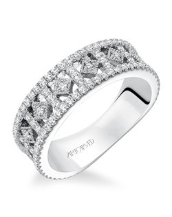 Contemporary prong set diamond fashion anniversary band with intricate open work pattern, totaling 5/8 carat.