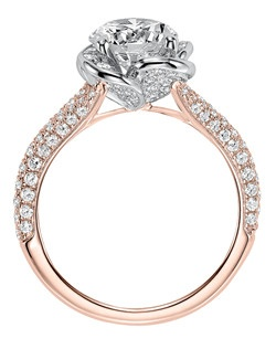 Katalina, Contemporary two tone diamond engagement ring with pave diamond accents within floral halo and diamond accented split shank in rose gold. Available in Platinum, 18K and 14K gold. Price listed below is for the setting only. Settings can be custom made to fit any size or shape center stone. Total weight of semi-mount 7/8 Ct. Matching band available - Style number V583GRR-L