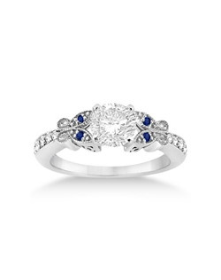 A total of 4 sapphires and 12 diamonds are displayed in this fancy diamond and blue sapphire engagement ring with butterfly design. The bright diamonds are of GH Color, VS Clarity. The color stones are natural.<p>This heirloom style colored gemstone bridal ring is crafted in a 14kt White Gold setting.<p>Design your own engagement ring by setting a center stone in the interchangeable head prong mounting.