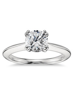 Start planning a proposal to remember with this beautiful engagement ring, crafted from striking platinum it showcases your choice of center diamond in a double-prong setting.