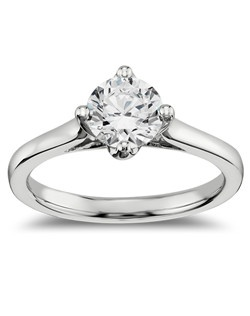 Show your love with this 14k white gold engagement ring, featuring a shimmering east west prong set solitaire diamond.