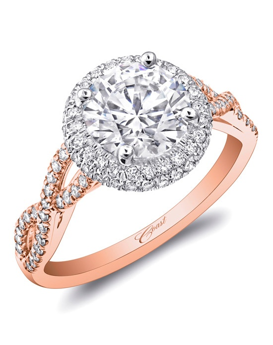 This exquisite engagement ring has it all: a round halo encrusted in diamonds, framed by strings of diamonds which twist down the sides of the finger. Total diamond weight .34CT, not including center stone. Created for a 1.5CT center stone in rose and white gold. Price range does not include center stone.