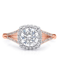 This beautifully refined split shank halo engagement ring from the Charisma Collection features petite round brilliant diamonds. Total diamond weight .17CT, not including center stone. Created for a 1CT center stone in rose and white gold. Price range does not include center stone.
