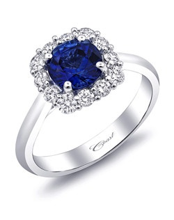 From the Coast Signature Color Collection, this ring features a gorgeous 1.08CT sapphire gemstone surrounded by a cushion-shaped halo of round diamonds, set in 14K white gold. Total Diamond weight: .47CT.