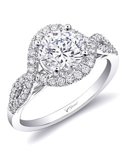 Strings of diamonds flatter the finger, as they intertwine to create a show-stopping halo. Total diamond weight .26CT, not including center stone. Created for a 1.5CT center stone in gold or platinum. Price range does not include center stone.