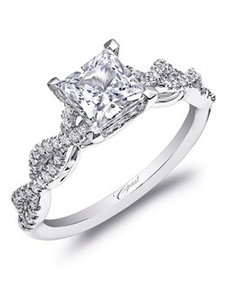 A strikingly beautiful design, this engagement ring features a double helix design on the band, leading the eye to a princess cut diamond. Standard size created for a 5.5mm center stone in gold or platinum. Total diamoind weight .23CT, not including center stone. Price range does not include center stone.