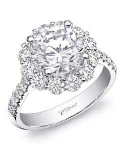 This stunning Charisma engagement ring features a sumptuous round diamond halo, as well as diamonds down the shoulders of the ring. Total diamond weight 1.22CT, not including center stone. Created for a 2CT center stone; available in gold or platinum. Price range does not include center stone.