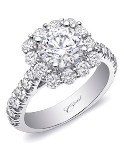 A glamorous engagement ring featuring round diamonds on the shoulders of the ring, crowned by a show-stopping cushion shaped diamond halo. Total diamond weight 1.4CT, not including center stone. Created for a 1.5CT center stone; available in gold or platinum. Price range does not include center stone.