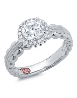 Available in White Gold 18KT and Platinum.0.24 RD.