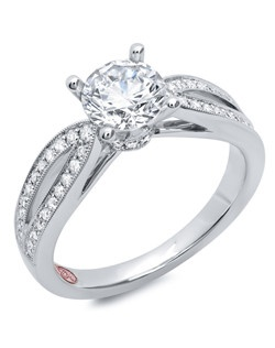 Available in White Gold 18KT and Platinum.0.33 RD. Price excludes center stone
