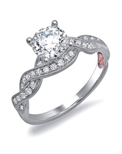Available in White or Yellow Gold 18KT and Platinum. 0.32 RD.