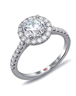Available in White or Yellow Gold 18KT and Platinum. 0.50 RD.