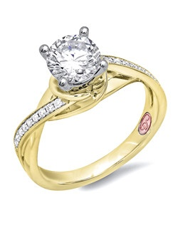 Available in White or Yellow Gold 18KT and Platinum. 0.10RD.