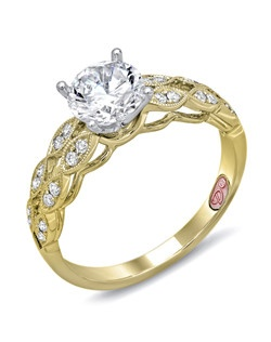 Available in White or Yellow Gold 18KT and Platinum. 0.16 RD.