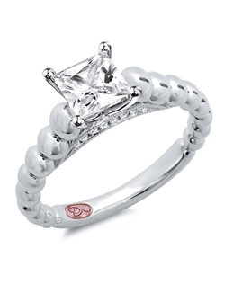 Available in White Gold 18KT and Platinum.0.05 RD.