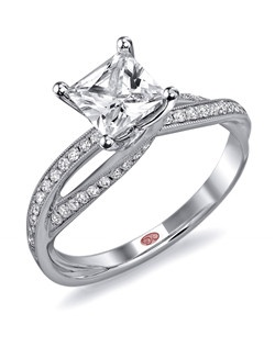 Available in White or Yellow Gold 18KT and Platinum. 0.28 RD.