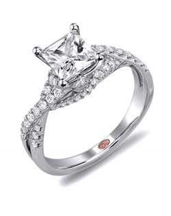 Available in White or Yellow Gold 18KT and Platinum. 0.37 RD.