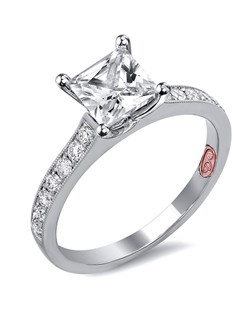 Available in White or Yellow Gold 18KT and Platinum. 0.27RD.