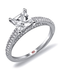 Available in White or Yellow Gold 18KT and Platinum. 0.30 RD.