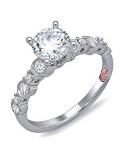 Available in White or Yellow Gold 18KT and Platinum. 0.33 RD.