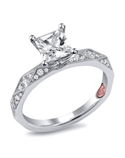Available in White or Yellow Gold 18KT and Platinum. 0.24 RD.