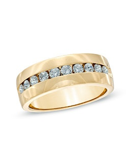 "An extraordinary gift for the man you love, this 14K yellow gold wedding band features a row of shimmering round diamonds showcased along a handsome channel setting. Buffed to a brilliant luster, this amazing 1 ct. t.w. diamond style is the perfect way to exchange vows and say, ""I do."""