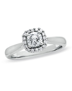 Celebrate your love with classic style. This stunning 14K white gold ring features a majestic 1/2 ct. round diamond center stone surrounded by a squared frame set with smaller accent diamonds. With a total diamond weight of 5/8 ct., this vintage-inspired ring is sure to win her heart - and her hand!