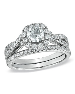 Give her a ring as breathtaking and beautiful as she is. This exceptional 1-1/6 ct. t.w. diamond bridal set will win her heart. Fashioned in 14K white gold, the engagement ring features a glittering 1/2 ct. round diamond center stone surrounded by a squared frame bordered with smaller accent diamonds. The twirling and twisting shank is set with additional round accent diamonds for extra sparkle. On your wedding day, speak your vows as you slip the coordinating diamond-lined wedding band on her waiting finger. Polished to a brilliant shine, this captivating bridal set conveys your promise of a bright future and a lifetime of love.