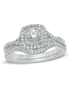 For the unforgettable moments in your life, celebrate with an expression of your love: a 3/4 ct. t.w. Celebration 102® diamond bridal set. Our exclusive diamond offers nearly twice the facets for substantially more sparkle. The engagement ring showcases a 1/4 ct. Celebration 102® diamond center stone bordered with a double frame of smaller accent diamonds, which also line the ring's split shank and the coordinating wedding band. Every Celebration 102® diamond received excellent rankings for superior cut and color. Insuring authenticity and protection, each diamond is laser-inscribed with a certification number inside of the band. This set arrives with a certificate that includes a photo and a description of the diamond, which guarantees quality and can be used for insurance purposes.