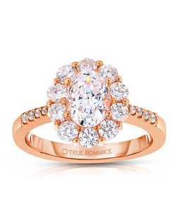 An elegant design, this diamond engagement ring showcases a prong-set diamond halo that crowns the Oval center stone. This style accommodates various center stone sizes & shapes. Available in Platinum, as well as 18K and 14K White, Yellow or Rose Gold. Priced as shown .84cts 14K Rose Gold.
