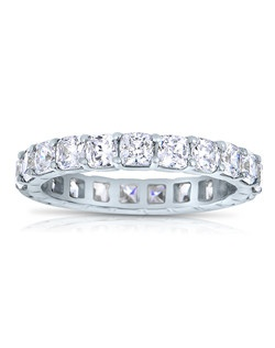 A classic design, this diamond eternity band showcases Cushion Cut diamonds that share a common prong. This style comes in multiple diamond weights as well as finger sizes from 3.5 to 10. Available in Platinum, as well as 18K and 14K White, Yellow or Rose Gold. Priced as shown 3.02cts 14K White Gold Size 7