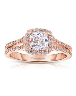 An elegant design, this diamond engagement ring showcases a prong-set diamond halo that crowns the center stone. This style accommodates various center stone sizes & shapes. Available in Platinum, as well as 18K and 14K White, Yellow or Rose Gold. Priced as shown .60cts 14K Rose Gold