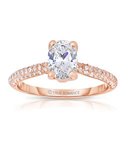 An elegant design, this diamond engagement ring showcases a pave set band that highlights the Oval center stone. This style accommodates various center stone sizes & shapes. Available in Platinum, as well as 18K and 14K White, Yellow or Rose Gold. Priced as shown .41cts 14K Rose Gold