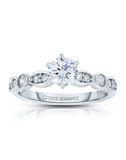 An elegant design, this diamond engagement ring showcases a diamond on an infinity style band. This style accommodates various center stone sizes & shapes. Available in Platinum, as well as 18K and 14K White, Yellow or Rose Gold. Priced as shown 0.18cts 14K White Gold