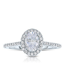 An elegant design, this diamond engagement ring showcases a prong-set diamond halo that crowns the center stone. This style accommodates various center stone sizes & shapes. Available in Platinum, as well as 18K and 14K White, Yellow or Rose Gold. Priced as shown 0.29cts 14K WG