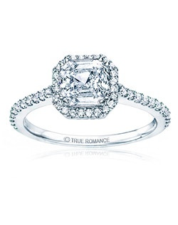 An elegant design, this diamond engagement ring showcases a prong-set diamond halo that crowns the Cushion Shaped center stone. This style accommodates various center stone sizes & shapes. Available in Platinum, as well as 18K and 14K White, Yellow or Rose Gold. Priced as shown 0.34cts 14K WG