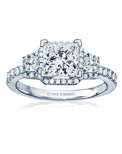 An elegant design, this diamond engagement ring showcases a prong-set diamond halo that crowns the center stone. This style accommodates various center stone sizes & shapes. Available in Platinum, as well as 18K and 14K White, Yellow or Rose Gold. Priced as shown .67cts 14K White Gold