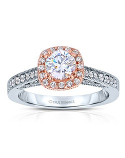 An elegant design, this diamond engagement ring showcases a prong-set diamond halo that crowns the center stone within a vintage styled design. This style accommodates various center stone sizes & shapes. Available in Platinum, as well as 18K and 14K White, Yellow or Rose Gold. Priced as shown 0.34cts 14K WG