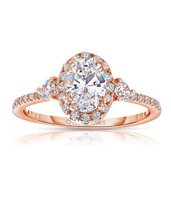 An elegant design, this diamond engagement ring showcases a prong-set diamond halo that crowns the center stone. This style accommodates various center stone sizes & shapes. Available in Platinum, as well as 18K and 14K White, Yellow or Rose Gold. Priced as shown 0.39cts 14K Rose Gold Price excludes center stone