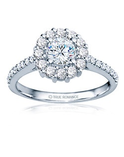 An elegant design, this diamond engagement ring showcases a prong-set diamond halo that crowns the round center stone. This style accommodates various center stone sizes & shapes. Available in Platinum, as well as 18K and 14K White, Yellow or Rose Gold. Priced as shown .64cts 14K WG Price excludes center stone