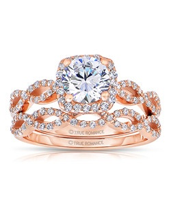 An elegant design, this diamond engagement ring showcases a prong-set diamond halo that crowns the center stone on top of an infinity styled ring. This style accommodates various center stone sizes & shapes. Available in Platinum, as well as 18K and 14K White, Yellow or Rose Gold. Priced as shown 0.33cts 14K Rose Gold. Band sold separately.