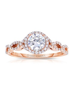 An elegant design, this diamond engagement ring showcases a prong-set diamond halo that crowns the center stone. This style accommodates various center stone sizes & shapes. Available in Platinum, as well as 18K and 14K White, Yellow or Rose Gold. Priced as shown 0.33cts 14K Rose Gold