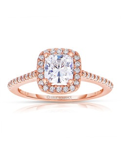 An elegant design, this diamond engagement ring showcases a prong-set diamond halo that crowns the Cushion Shaped center stone. This style accommodates various center stone sizes & shapes. Available in Platinum, as well as 18K and 14K White, Yellow or Rose Gold. Priced as shown 0.31cts 14K Rose Gold