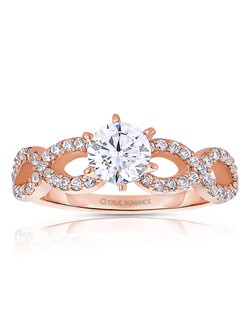 An elegant design, this diamond engagement ring showcases your center stone on top of an infinity styled ring. This style accommodates various center stone sizes & shapes. Available in Platinum, as well as 18K and 14K White, Yellow or Rose Gold. Priced as shown 0.54cts 14K Rose Gold