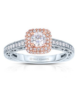 An elegant design, this diamond engagement ring showcases a prong-set diamond halo that crowns the center stone within a vintage styled design. This style accommodates various center stone sizes & shapes. Available in Platinum, as well as 18K and 14K White, Yellow or Rose Gold. Priced as shown 0.51cts 14K WG