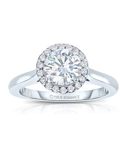An elegant design, this diamond engagement ring showcases a prong-set diamond halo that crowns the center stone. This style accommodates various center stone sizes & shapes. Available in Platinum, as well as 18K and 14K White, Yellow or Rose Gold. Priced as shown 0.20cts 14K White Gold Price excludes center stone