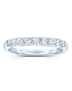 A classic design, this low profile diamond band showcases diamonds that share a common prong. This style comes in multiple diamond weights as well as finger sizes from 3.5 to 10. Available in Platinum, as well as 18K and 14K White, Yellow or Rose Gold. Priced as shown 0.72cts 14K White Gold Size 7