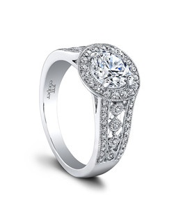(0.37 ttl) An iconic beauty. The Halle Engagement Ring has an unmistakable star quality. A haloed center stone recalls a flower in bloom, a floral motif echoed by an intricate pattern of accent diamonds. Halle's bold, striking silhouette makes your hand look beautifully delicate in comparison. Can be custom made to fit any shape center stone. Hand crafted in either Platinum, 18K Gold or 14K Gold.(Price Details:Price excludes center stone)